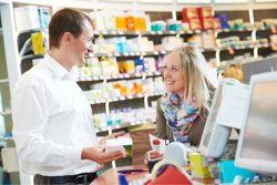 pharmacist assisting client